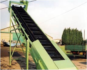 Side wall belt elevator for heavy duty requirements