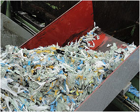 Washed and dried plastic coming of screw compactor